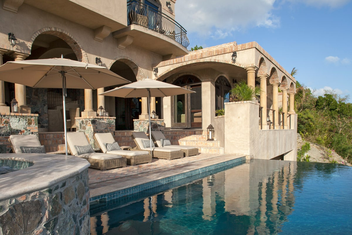 Chaise Lounges, Umbrellas And Pool
