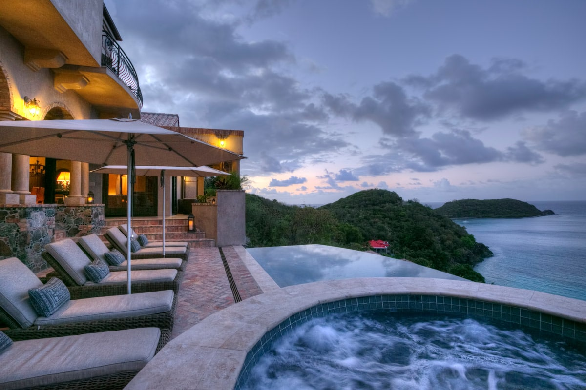 Chaise Lounges, Hot Tub And Pool At Dusk